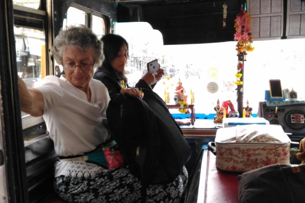 Mom learns what travel on a budget is all about with the Orange public busses in Surat Thani town